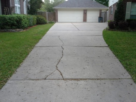 WHAT CAUSES SLABS OF CONCRETE SIDEWALK TO CRACK AND BREAK INTO MORE PIECES?